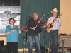 Margot with the Moonee Valley Drifters with Adam Gare on fiddle, and Nick on guitar.